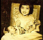 Young SRK in his sister\'s lap